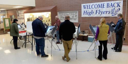Al Hartmann  |  The Salt Lake Tribune Voting booths were full in early morning voting at precinct SLC 108 at Hawthorne Elementary School in Salt Lake City Tuesday November 4.