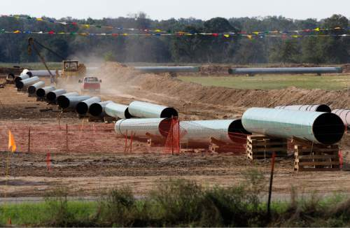 File - In this Oct. 4, 2012 file photo, large sections of pipe are shown in Sumner, Texas. Republicans are counting on a swift vote in early 2015 on building the Keystone XL pipeline to carry oil from Canada to the U.S. Gulf Coast now that Republicans clearly have the numbers in the Senate. (AP Photo/Tony Gutierrez, File)