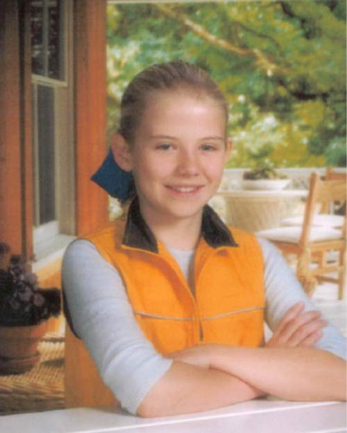 """Elizabeth Smart : age 14, height 5'6"""", weight 105 lbs., white, blonde hair, fair complexion, blue eyes. last seen wearing red satin, oriental short sleeve pajamas absucted June 5, 2002 from Salt Lake City Utah.  undated photo/ handout from Salt Lake City Police Deptartment"""