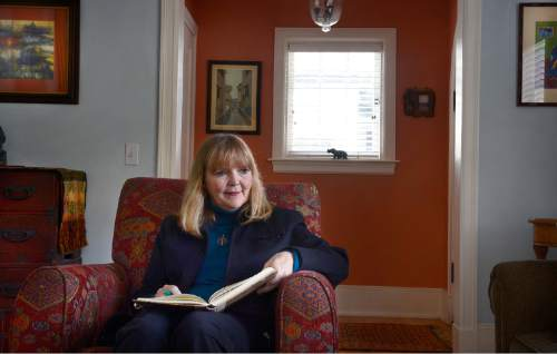 Scott Sommerdorf  |  The Salt Lake Tribune The Rev. Patty Willis, pastor at South Valley Unitarian Universalist Church, reads in her living room in Salt Lake City home, Thursday, November 6, 2014.