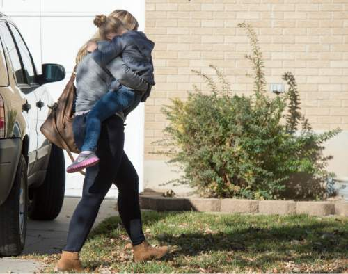 Rick Egan  |  The Salt Lake Tribune  A Sandy family returns home with their daughter after the girl's father rescued her from a man who tried to kidnap her on Friday, November 7, 2014.