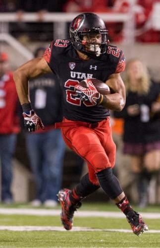 Rick Egan  |  The Salt Lake Tribune   Ute running back Devontae Booker (23) runs the ball, in PAC-12 action, Utah vs. Oregon game, at Rice-Eccles Stadium, Saturday, November 8, 2014