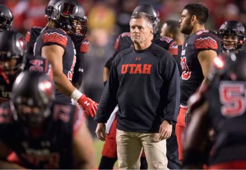 Rick Egan  |  The Salt Lake Tribune  Utah Utes head coach Kyle Whittingham watches his team warm up before that Utah vs. Oregon game, at Rice-Eccles Stadium, Saturday, November 8, 2014