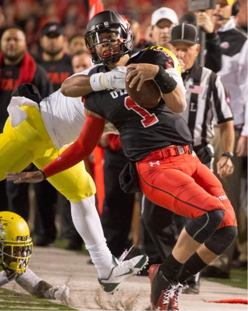 Rick Egan  |  The Salt Lake Tribune  Utah Utes quarterback Kendal Thompson (1) runs the ball, In PAC-12 action, Utah vs. Oregon game, at Rice-Eccles Stadium, Saturday, November 8, 2014