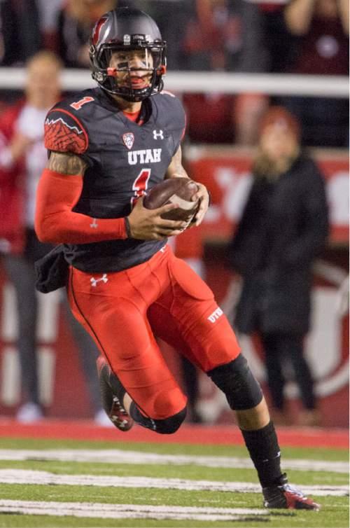 Rick Egan  |  The Salt Lake Tribune  Utah Utes quarterback Kendal Thompson (1) runs on a quarterback keeper, in PAC-12 action, Utah vs. Oregon game, at Rice-Eccles Stadium, Saturday, November 8, 2014