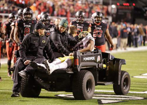 Oregon tight end Pharaoh Brown (85) is taken from the field after being injured in the fourth quarter during an NCAA college football game against Utah Saturday, Nov. 8, 2014, in Salt Lake City. (AP Photo/Rick Bowmer)