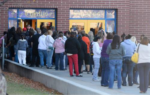 Francisco Kjolseth  |  The Salt Lake Tribune Long lines form outside Cyprus High with parents having to pick up their kids after police put four area schools on lockdown in Magna after reports that a student brought a gun to Brockbank Jr. High on Tuesday, Nov. 11, 2014. The weapon turned out to be a toy.