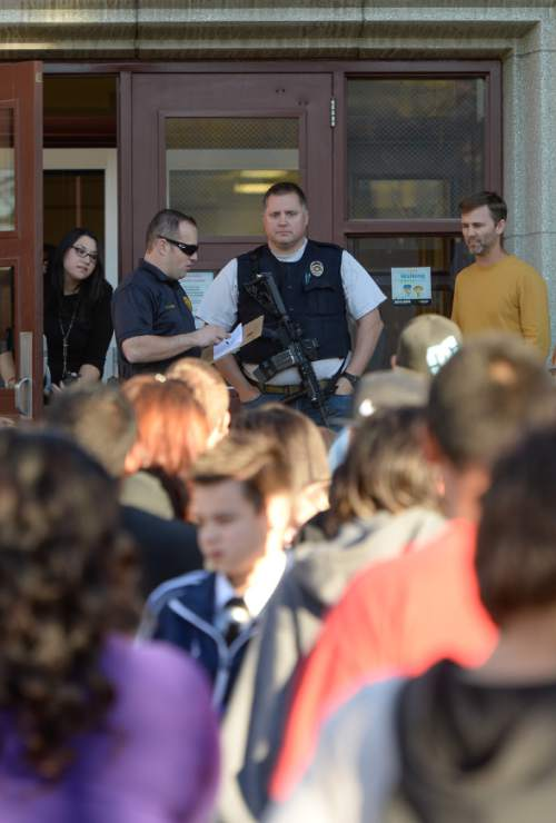 Francisco Kjolseth  |  The Salt Lake Tribune Students are allowed to leave Brockbank Jr. High in Magna after Unified Police put four area schools on lockdown following reports that a student brought a gun to to the school on Tuesday, Nov. 11, 2014. The weapon turned out to be a toy.