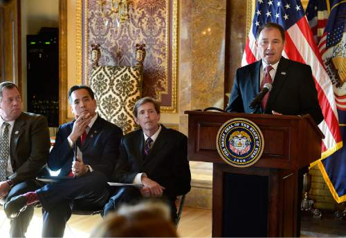 Scott Sommerdorf  |  The Salt Lake Tribune Utah Governor Gary Herbert speaks during the press conference in which Utah's Criminal and Juvenile Justice Commission released a package of proposals aimed at reducing the population and costs of the state's prison system, Wednesday, November 12, 2014. At left are; Representative Eric Hutchings, R-Kearns, Attorney General Sean Reyes, and Chief Justice Matthew Durrant.