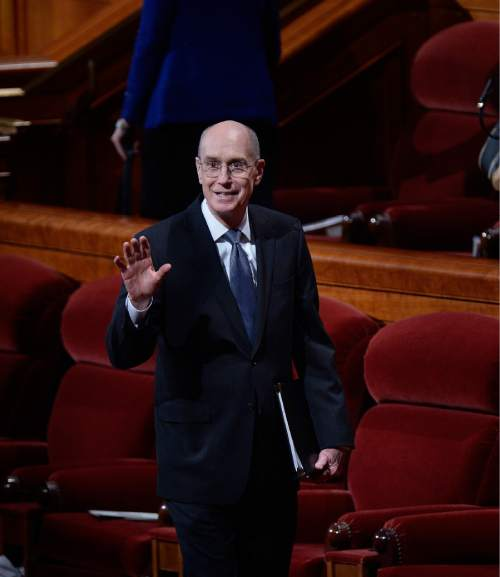 Scott Sommerdorf  |  The Salt Lake Tribune President Henry B. Eyring waves as he leaves the morning session of the 184th Semiannual General Conference of the Church of Jesus Christ of Latter Day Saints, Sunday, October 5, 2014.