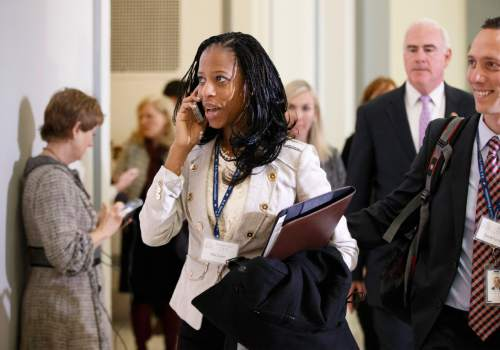 Rep.-elect Mia Love, R-Utah, arrives with her husband Jason Love, right, on Capitol Hill in Washington, Thursday, Nov. 13, 2014, as House Republicans arrive to choose their leadership for the 114th Congress that convenes in January.  (AP Photo/J. Scott Applewhite)