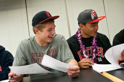Chris Detrick  |  The Salt Lake Tribune Sean Barton and Filipo Mokofisi sign their letter of intent at Woods Cross High School on National Signing Day Wednesday February 6, 2013. Barton will be playing football at Stanford and Mokofisi will be playing football at University of Utah.