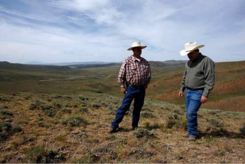 Francisco Kjolseth  |  The Salt Lake Tribune Brothers Blaine, left, and Brent Tanner stand at the division of the Great Basin and the Columbia River Basin with their ranch in the distance where they have been involved in creating Sage Grouse habitat.  The cattlemen along with their brother Jay Tanner have been awarded conservation awards for the management of their operation, Della Ranches.  They run up to 1,000 cattle on some 192,000 acres of private, state-an Federally owned lands in the Grouse Creek Valley. The three are partners in a family ranch that's been operating in Box Elder County for more than 130 years.