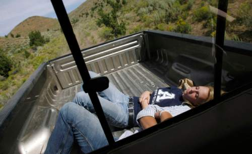 Francisco Kjolseth  |  The Salt Lake Tribune Andrea Tanner, 18, catches some shut eye along with her friend Kaleb Payne as her father Brent Tanner maneuvers the truck through some of the lands around Grouse Creek where juniper trees have been managed to create more grasses and habitat for Sage Grouse. Cattlemen and brothers Blaine, Jay and Brent Tanner have been awarded conservation awards for the management of their operation, Della Ranches.  They run up to 1,000 cattle on some 192,000 acres of private, state-an Federally owned lands in the Grouse Creek Valley. The three are partners in a family ranch that's been operating in Box Elder County for more than 130 years.