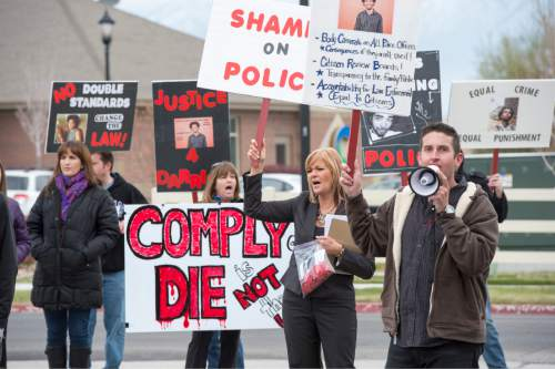 Rick Egan  |  The Salt Lake Tribune  Supporters chant during a rally in front of the Saratoga Springs Police station, for justice for Darrien Hunt, who was fatally shot by two Saratoga Springs police officers on Sept. 10, 2014, after allegedly swinging a samurai-type sword at the officers.Friday, November 14, 2014