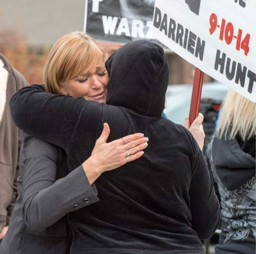 Rick Egan  |  The Salt Lake Tribune  Darrien Hunt's aunt, Cindy Moss, gets a hug from Mystic Young, after making  a speech to supporters, during a rally in  Saratoga Springs , for justice for Darrien Hunt, Friday, November 14, 2014