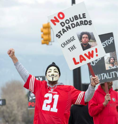 Rick Egan  |  The Salt Lake Tribune  Keven Irons chants behind a mask, during a rally in Saratoga Springs, for Darrien Hunt, who was fatally shot by two Saratoga Springs police officers on Sept. 10, 2014, after allegedly swinging a samurai-type sword at the officers.Friday, November 14, 2014