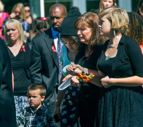 Steve Griffin  |  The Salt Lake Tribune   Susan Hunt is consoled as she follows pallbearers as they carry the casket of her son, Darrien Hunt, following funeral services at the Saratoga Springs North Stake Center in in Saratoga Springs, Utah Thursday, September 18, 2014. Police officers in Saratoga Springs shot and killed Hunt on Sept. 10, 2014.