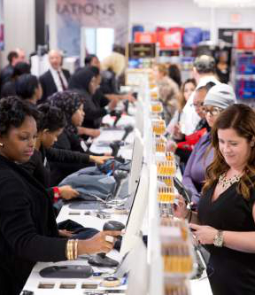 In this Oct. 28, 2014 photo, customers check out at the new department store in Philadelphia.. (AP Photo/Matt Rourke)