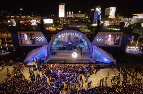 Steve Griffin   Tribune File With downtown Salt Lake City in the background people surround the stage at the Olympics Medals Plaza during the opening night of the downtown venue Feb. 9, 2002.
