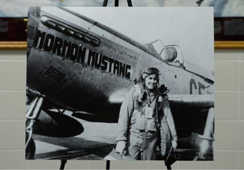 "Francisco Kjolseth  |  The Salt Lake Tribune The Utah Air National Guard Base east of SLC International is renamed for retired Brig. Gen. Roland Wright, who flew the ""Mormon Mustang"" during World War II, seen here in a historical photograph."
