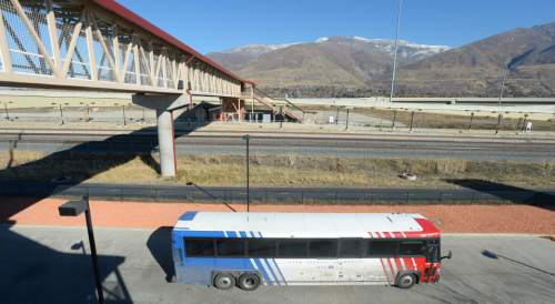 Steve Griffin     The Salt Lake Tribune  A bus transports riders to the Farmington's Station Park and Ride/FrontRunner Station Monday, November 17, 2014 in Farmington, Utah. Mayors, county commissioners and business leaders gathered at the station to call for more funding for transportation in Utah.
