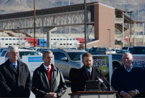 Steve Griffin     The Salt Lake Tribune  Rep. Johnny Anderson of Taylorsville talks during a press conference at Farmington's Station Park and Ride/FrontRunner Station Monday, November 17, 2014. Mayors, county commissioners and business leaders gathered to call for more funding for transportation in Utah.