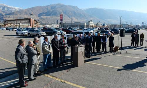 Steve Griffin     The Salt Lake Tribune Utah business and political leaders talk during a press conference at Farmington's Station Park and Ride/FrontRunner Station Monday, November 17, 2014. Mayors, county commissioners and business leaders gathered to call for more funding for transportation in Utah.