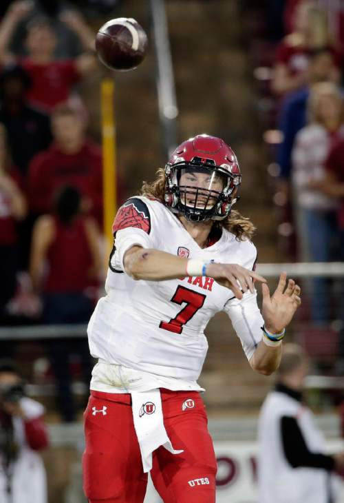 Utah quarterback Travis Wilson (7) throws against the Stanford during the second half of an NCAA college football game on Saturday, Nov. 15, 2014, in Stanford, Calif. Utah won 20-17 in overtime. (AP Photo/Marcio Jose Sanchez)