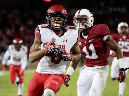Utah wide receiver Kaelin Clay, center,  runs into the end zone with a touchdown catch next to Stanford cornerback Terrence Alexander (11) during overtime of an NCAA college football game on Saturday, Nov. 15, 2014, in Stanford, Calif. Utah won 20-17. (AP Photo/Marcio Jose Sanchez)