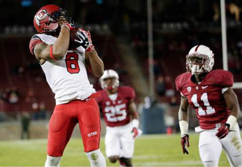 Utah wide receiver Kaelin Clay, left, makes a touchdown catch next to Stanford cornerback Terrence Alexander (11) during overtime of an NCAA college football game on Saturday, Nov. 15, 2014, in Stanford, Calif. Utah won 20-17. (AP Photo/Marcio Jose Sanchez)