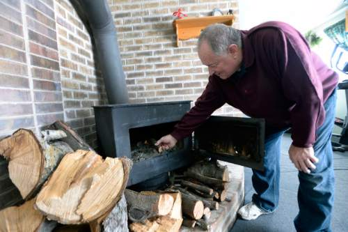 Al Hartmann     The Salt Lake Tribune Doug Fay of Kearns stokes his homemade steel plate wood stove a friend built in 1977.  He has used it as his only heat source, but this year Breathe Utah covered the cost of replacing his broken gas furnace. Wood smoke plays a surprisingly large impact on the Wasatch Front's wintertime air quality so the state is encouraging residents to convert wood-burning devices to natural gas.