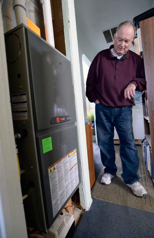 Al Hartmann     The Salt Lake Tribune Doug Fay with the new gas furnace Breathe Utah purchased. He has long heated his Kearns home with a homemade steel plate wood-burning stove. Wood smoke plays a surprisingly large impact on the Wasatch Front's wintertime air quality so the state is encouraging residents to convert wood-burning devices to natural gas..
