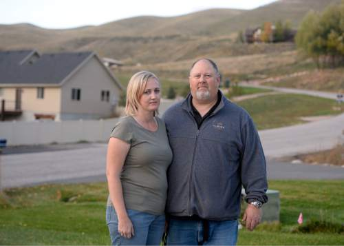 Rick Egan     The Salt Lake Tribune   Martha and Clayton Ericson in front of their Morgan home, where they say a former neighbor filled the subdivision with smoke from a wood-fired boiler. The smoke triggered a lawsuit and illustrates the air-quality impacts of burning wood, but a judge concluded this smoke did not pose a nuisance.  Wednesday, October 15, 2014