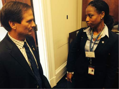 Thomas Burr  |  The Salt Lake Tribune  Rep. Chris Stewart talks to Rep.-elect Mia Love on Wednesday as Love was scouting for a new office suite in the Cannon House Office Building. Stewart, who is on the third floor, will have his Utah Republican colleague as a neighbor soon, with Love picking a suite on the second floor.