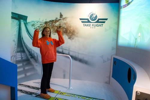 Chris Detrick  |  The Salt Lake Tribune Sam Macuga, 13, of Park City, tries out the new virtual ski jump at the Alf Engen Ski Museum in Utah Olympic Park Wednesday November 19, 2014.
