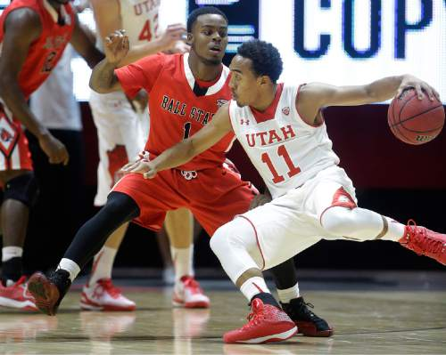 Ball State's Zavier Turner (1) defends Utah's Brandon Taylor (11) during the first half of an NCAA college basketball game Friday, Nov. 14, 2014, in Salt Lake City. (AP Photo/Rick Bowmer)