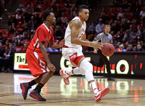 Utah's Jordan Loveridge, right, drives to the basket as Ball State's Jeremie Tyler defends during the second half of an NCAA college basketball game Friday, Nov. 14, 2014, in Salt Lake City. (AP Photo/Rick Bowmer)