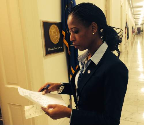 Thomas Burr  |  Tribune file photo Rep.-elect Mia Love checks over a list of her favorite offices to pick from two weeks after winning election.