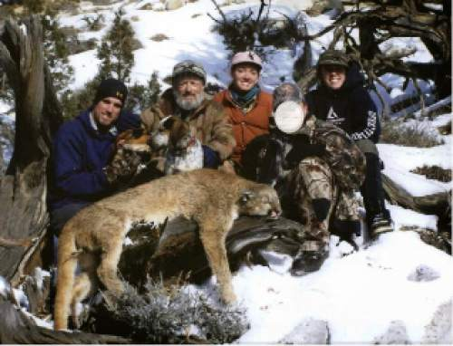 Courtesy Colorado Parks and Wildlife Nicholaus Rodgers, left, Christopher Loncarich, Andie Loncarich, an unidentified hunter and Caitlin Loncarich sit with a mountain lion killed in Utah without a license, then illegally checked in Colorado. Loncarich was sentenced to 27 months in prison and three years probation for conspiring to violate the Lacey Act, a federal law prohibiting the interstate transportation and sale of any wildlife taken in an illegal manner.