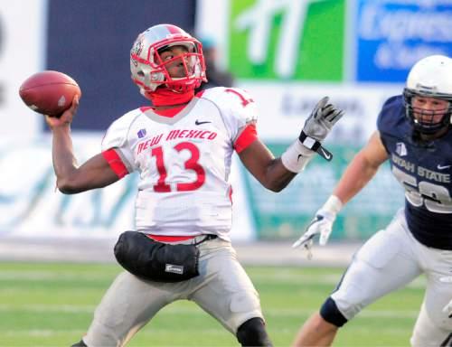 New Mexico quarterback Lamar Jordan (13) throws the ball as Utah State linebacker Zach Vigil (53) rushes in during an NCAA college football game Saturday, Nov. 15, 2014, in Logan, Utah. (AP Photo/The Herald Journal, Eli Lucero)