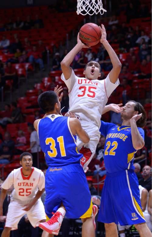 Leah Hogsten     The Salt Lake Tribune Utah Utes forward Kyle Kuzma (35) drives to the net. The University of Utah defeated the UC Riverside Highlanders, 88-42, November 21, 2014, at the Jon M. Huntsman Center.