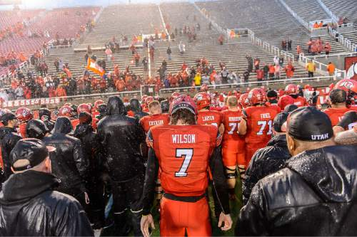 """Trent Nelson     The Salt Lake Tribune Utah Utes quarterback Travis Wilson (7) and the team sings """"Utah Man"""" with the few fans who stayed to the bitter end as the University of Utah Utes lose to the Arizona Wildcats, college football at Rice-Eccles Stadium in Salt Lake City Saturday November 22, 2014."""