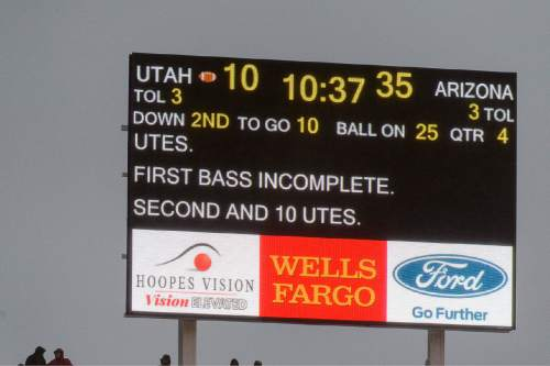 """Trent Nelson     The Salt Lake Tribune As the scoreboard reads, """"First bass incomplete,"""" as the University of Utah Utes hosts the Arizona Wildcats, college football at Rice-Eccles Stadium in Salt Lake City Saturday November 22, 2014."""