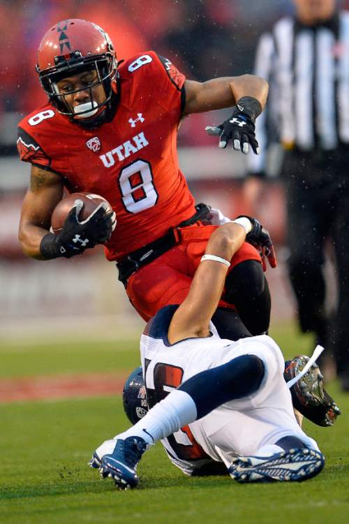 Chris Detrick  |  The Salt Lake Tribune Utah Utes wide receiver Kaelin Clay (8) is tackled by Arizona Wildcats safety Jourdon Grandon (26) during the game at Rice-Eccles Stadium Saturday November 22, 2014.