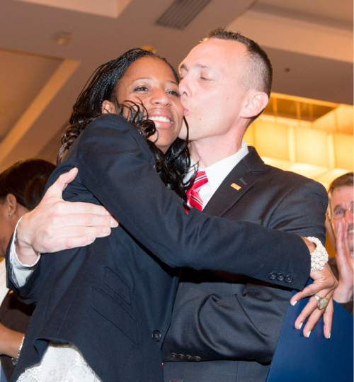 Steve Griffin  |  The Salt Lake Tribune  Mia Love gets a kiss from her husband Jason after defeating opponent Doug Owens in the race for Utah's 4th Congressional District, Tuesday November 4, 2014.