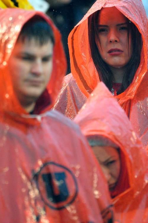 Chris Detrick     The Salt Lake Tribune Utah fans attempt to keep dry during the game at Rice-Eccles Stadium Saturday November 22, 2014. Arizona Wildcats defeated Utah Utes 42-10.