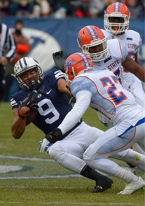 Leah Hogsten     The Salt Lake Tribune Brigham Young Cougars wide receiver Jordan Leslie (9) grimaces as he slips and falls in front of Savannah State Tigers defensive back Alfred Ansley (27). Brigham Young University leads Savannah State 51-0 at the half, November 22, 2014, at LaVell Edwards Stadium in Provo.