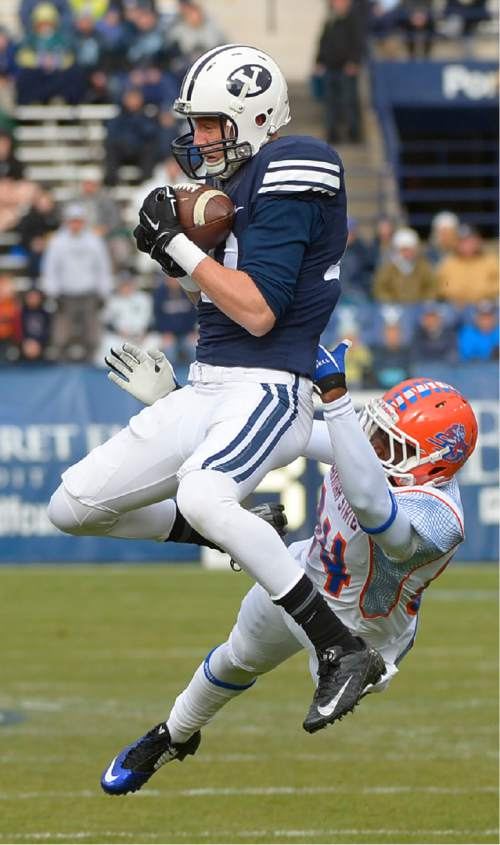 Leah Hogsten  |  The Salt Lake Tribune Brigham Young Cougars wide receiver Mitch Mathews (10) catches a 71-yd pass and slips past Savannah State Tigers wide receiver Dylan Cook (84) for the first touchdown of the game. Brigham Young University leads Savannah State 51-0 at the half, November 22, 2014, at LaVell Edwards Stadium in Provo.