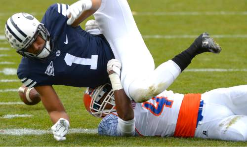 Leah Hogsten  |  The Salt Lake Tribune Brigham Young Cougars wide receiver Ross Apo (1) fumbles a catch and tackled by Savannah State Tigers cornerback John Wilson (4). Brigham Young University leads Savannah State 51-0 at the half, November 22, 2014, at LaVell Edwards Stadium in Provo.